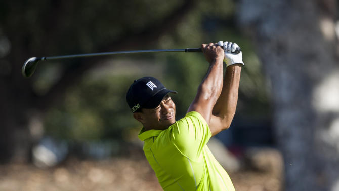 Tiger Woods hit a shot off the fairway on the fifth hole during the pro-am of the World Challenge golf tournament, at Sherwood Country Club in Thousand Oaks, Calif., Wednesday, Nov. 28, 2012. (AP Photo/Bret Hartman)