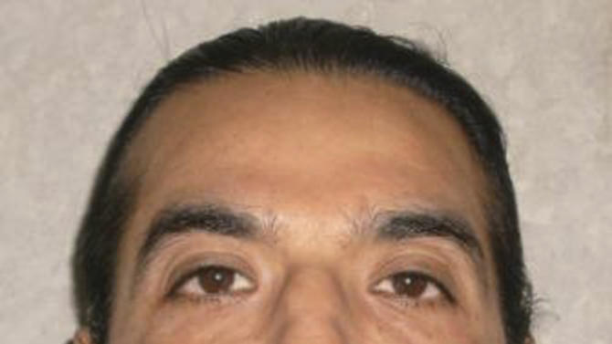 In this June 29. 2011 photo provided by the Oklahoma Department of Corrections, George Ochoa is pictured. U.S. District Judge David Russell on Monday, Dec. 3, 2012 denied  Ochoa's attempt for a stay of execution. Ochoa is scheduled for execution Dec. 4, 2012, for the 1993 killings of an Oklahoma City couple. (AP Photo/Oklahoma Department of Corrections)