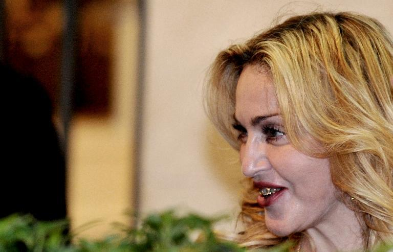 US pop star Madonna smiles in central Rome on August 21, 2013