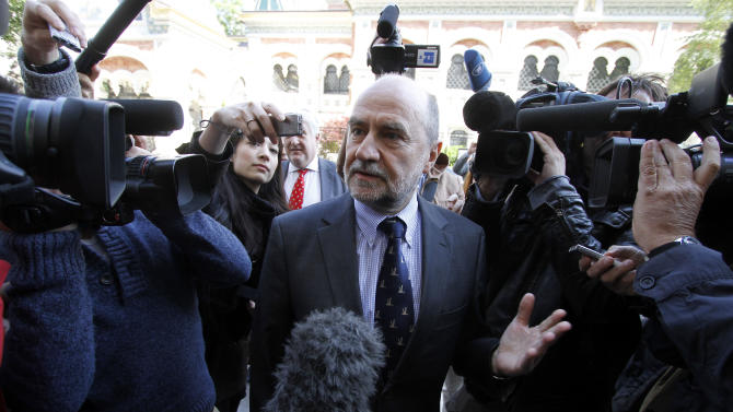 Herman Nackaerts, Deputy Director General and Head of the Department of Safeguards of the International Atomic Energy Agency, IAEA, speaks to journalists as he arrives for talks with Iran at the permanent mission of Iran in Vienna, Austria, Tuesday, May 15, 2012. The U.N. nuclear agency has started new talks with Iran Monday, aimed at getting access to what it suspects was the site of secret tests to make nuclear arms. (AP Photo/Ronald Zak)