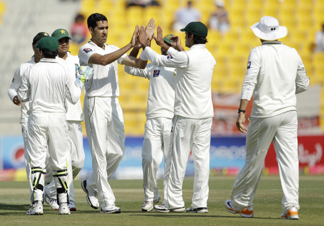 Pakistan's Umar Gul, fourth left, celebrates with his teammates after taking the wicket of England's Ian Bell, not pictured, lbw during the third day of their second cricket test match of a three-matc