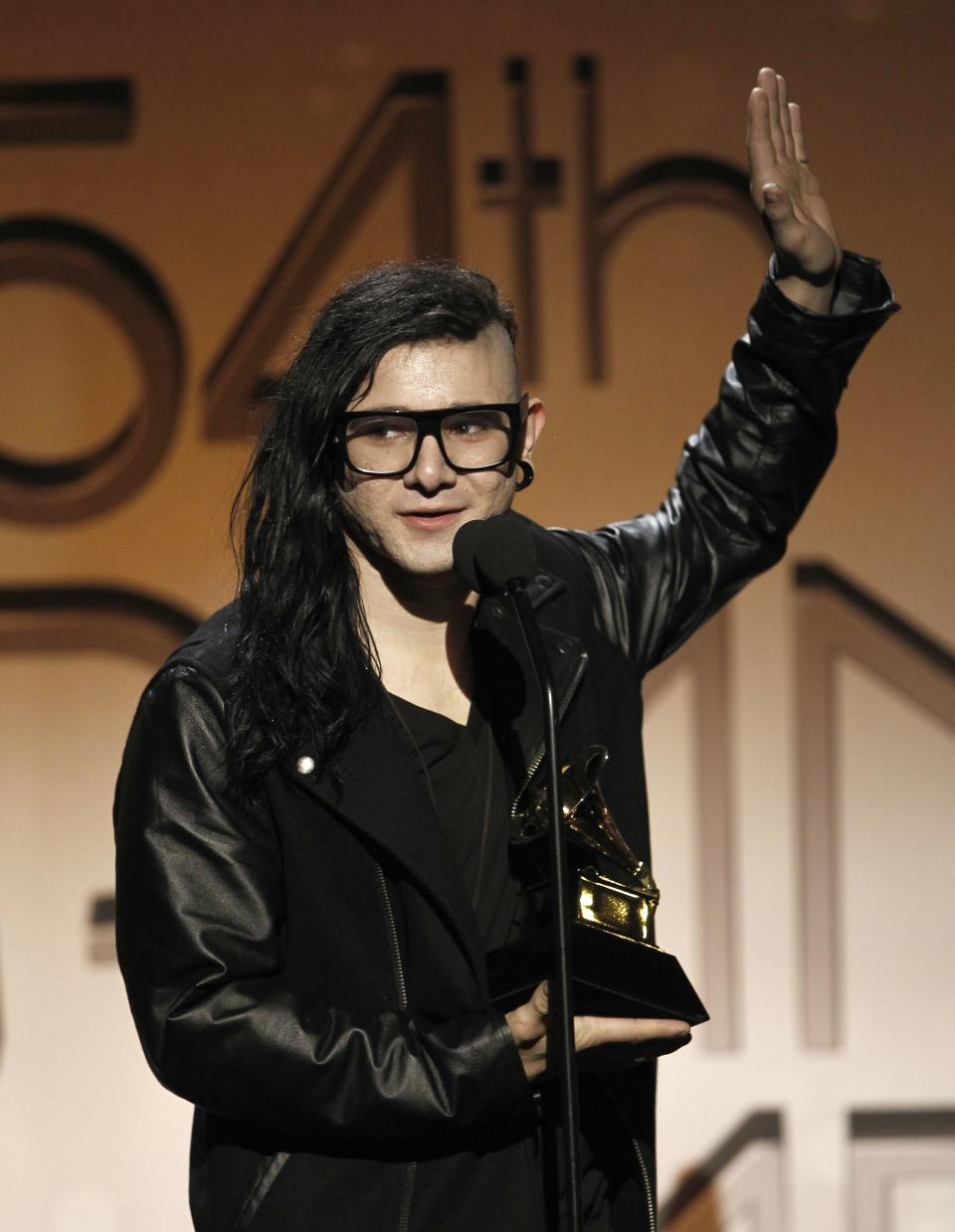 Skrillex accepts the award for best remixed recording non-classical, for Cinema, at the 54th annual GRAMMY Awards pre-show on Sunday, Feb. 12, 2012 in Los Angeles. (AP Photo/Matt Sayles)