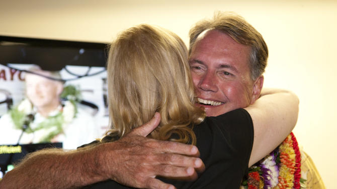 Hawaii politician Ed Case embraces a supporter at his campaign headquarters Saturday, Aug. 11, 2012 in Honolulu.  Case is running for the Democratic nomination for a Hawaii seat in the U.S. Senate.  Saturday's contest is the first since 1976 without an incumbent running, and whoever wins will become just the sixth senator in the state's 53-year history, replacing retiring Democratic Sen. Daniel Akaka.    (AP Photo/Marco Garcia)