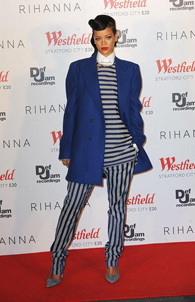 Rihanna prepares for first of two London shows - NaNa saved the cheeky look for London, appropriately, turning up in a Raf Simons cobalt coat and white collared shirt layered under a Spring 2013 Acne