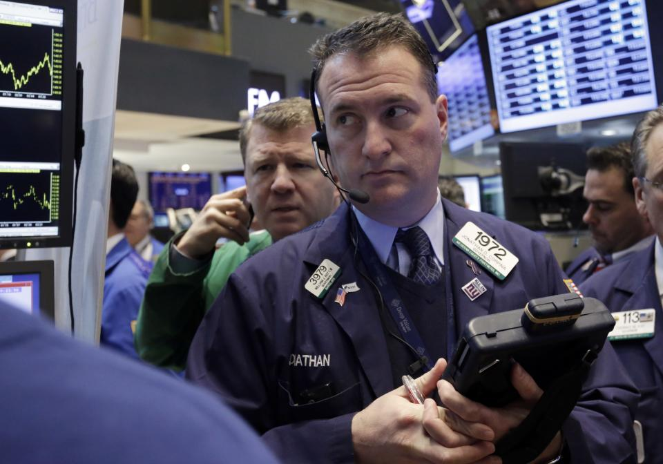 Stocks edge lower after economy report