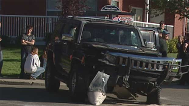 Police are crediting the man behind the wheel of this Hummer with preventing an alleged distracted driver from hitting four children in a crosswalk.