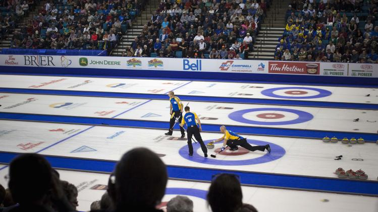 Team Alberta lead Nolan Thiessen delivers a stone in the 3rd end against team British Columbia during the championship draw at the 2014 Tim Hortons Brier curling championships in Kamloops.