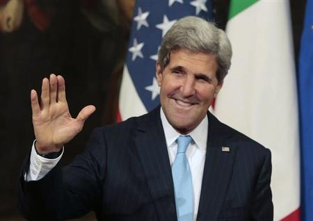 U.S. Secretary of State John Kerry waves as he arrives to attend a meeting with Italy's Prime Minister Enrico Letta at Chigi Palace in Rome October 23, 2013. REUTERS/Tony Gentile