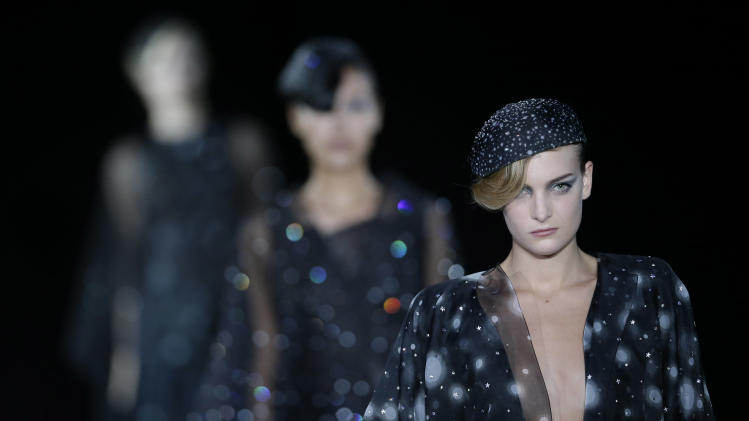 Model wear creations part of the Giorgio Armani women's Spring-Summer 2013 collection that was presented in Milan, Italy, Sunday, Sept. 23, 2012. (AP Photo/Luca Bruno)