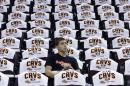 Zach Kokinda, 18, waits for the second-round NBA basketball playoff series game between the Chicago Bulls and the Cleveland Cavaliers to begin Monday, May 4, 2015, in Cleveland. The Cavaliers canceled a plan to give away 20,000 arm slings to fans to show support for injured starting forward Kevin Love, who is out for the rest of the NBA playoffs. The Cavs handed out small white towels for Tuesday's game against the Bulls. (AP Photo/Tony Dejak)