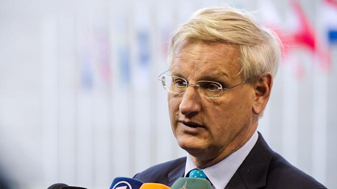 "FILE - A Monday, June 24, 2013 photo from files showing Swedish Foreign Minister Carl Bildt, as he talks with journalists on his arrival at a European foreign ministers meeting in Luxembourg. Left-wing and Internet freedom activists are likely to protest against U.S. online spying when Barack Obama visits Stockholm this week, but Swedish government officials say they won't raise the sensitive issue with the U.S. president. Foreign Minister Carl Bildt told The Associated Press on Monday, Sept. 2, 2013, that Internet surveillance activities are happening worldwide and that ""we are not entirely innocent ourselves. We conduct both intelligence and security operations on the Net. But they are regulated by law."" Bildt also noted that the European Union already is in discussions about ""data privacy"" with the United States.(AP Photo/Geert Vanden Wijngaert, File)"