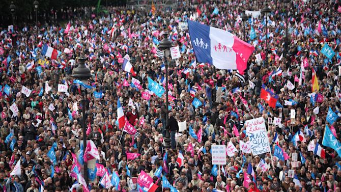 Anti gay marriage protestors gather during a demonstation against French President Francois Hollande's social reform on gay marriage and adoption, in Paris, Sunday, May 26, 2013. The law came into force over a week ago, but organizers decided to go forward with Sunday's long-planned demonstration to show their continued opposition as well as their frustration with President Francois Hollande, who had made legalizing gay marriage one of his keynote campaign pledges in last year's election. (AP Photo/Thibault Camus)