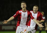 Crawley's Billy Clarke celebrates scoring his second goal