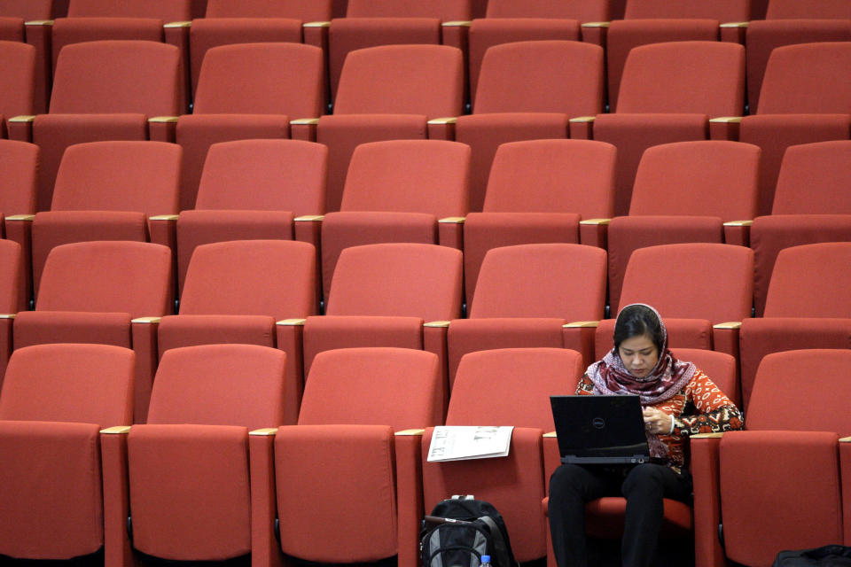 Vietnamese reporter Linh Tran covers the Nonaligned Movement summit in Tehran, Iran, Friday, Aug. 31, 2012. (AP Photo/Vahid Salemi)