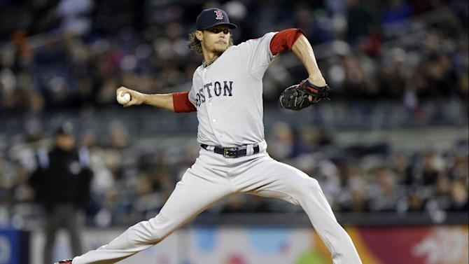 Boston Red Sox starting pitcher Clay Buchholz winds up in the first inning of a baseball game against the New York Yankees at Yankee Stadium in New York, Wednesday, April 3, 2013. (AP Photo/Kathy Willens)