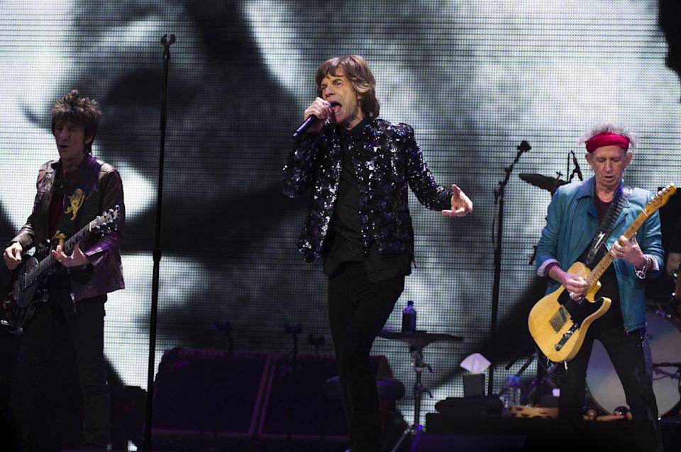 Ronnie Woods, from left, Mick Jagger and Keith Richards of The Rolling Stones perform in concert on Saturday, Dec. 8, 2012 in New York. (Photo by Charles Sykes/Invision/AP)