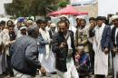 "In this photo taken on Wednesday, Sept. 17, 2014, Hawthi Shiite dance with traditional daggers named ""jambiya"" during a protest in a main road leading to the airport in Sanaa, Yemen. Security officials say Shiite rebels have reached a suburb of Yemen's capital where they are fighting Sunni militias and besieging a university run by one of the nation's best known Sunni radicals. The officials say Thursday's fighting on Sept. 18, 2014 in Shamlan has forced thousands to flee their homes, but they have no word on casualties. They say the rebels, known as Hawthis, are surrounding the Iman University, an institution long viewed as a primary breeding ground for militants. (AP Photo/Hani Mohammed)"