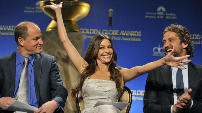 "CORRECTS DATE TO THURDAY DEC. 15 -- Actress Sofia Vergara, center, reacts alongside fellow presenters Woody Harrelson, left, and Gerard Butler after she was nominated for Best Performance by an Actress in a Supporting Role in a Series, Mini-Series or Motion Picture Made for Television for ""Modern Family,"" during nominations for the 69th Annual Golden Globe Awards, Thursday, Dec. 15, 2011, in Beverly Hills, Calif. The Golden Globe Awards will be held on Sunday, Jan. 15, 2012, in Beverly Hills, Calif. (AP Photo/Chris Pizzello)"