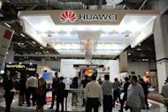 File picture from June shows visitors at the Huawei booth at an expo in Singapore. Chinese telecom giants Huawei and ZTE pose a security threat to the United States and should be barred from US contracts and acquisitions, a congressional probe has concluded