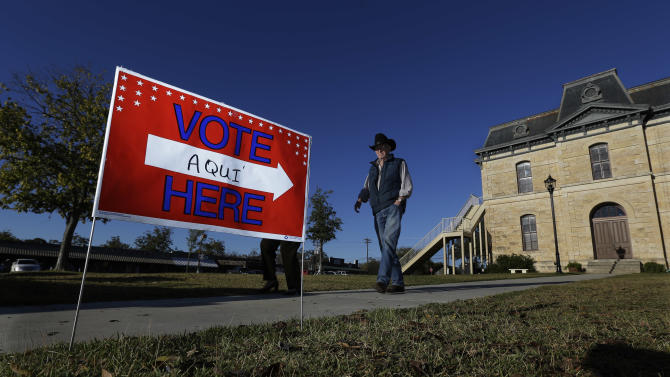 Voters leave the Old Blanco Courthouse after casting their ballots, Tuesday, Nov. 6, 2012, in Blanco, Texas. (AP Photo/Eric Gay)