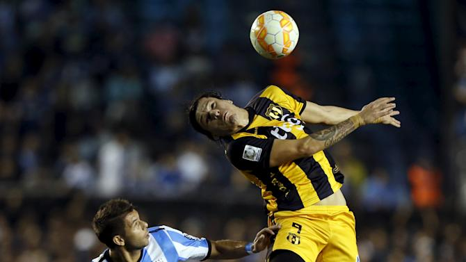 Santander of Paraguay's Guarani jumps for a header next to Grimi of Argentina's Racing Club during their Copa Libertadores quarter-final second leg soccer match in Buenos Aires