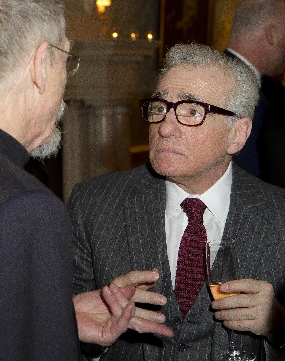 U.S director Martin Scorsese, right, chats to British actor John Hurt during a pre Bafta drinks reception for Scorsese at Claridges in London, Friday, Feb. 10, 2012.  Scorsese receives the Bafta Fellowship award during the ceremony on Sunday. (AP Photo/Joel Ryan)