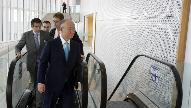 Director General of the International Atomic Energy Agency, IAEA, Yukiya Amano from Japan arrives for the IAEA board of governors meeting at the International Center, in Vienna, Austria, on Tuesday, March 6, 2012. (AP Photo/Ronald Zak)