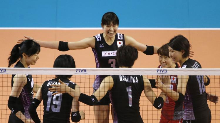 Kimura of Japan and her teammates react after winning a point against Turkey during their FIVB Women's Volleyball World Grand Prix 2014 final round match in Tokyo