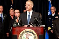 "US Attorney General Eric Holder addresses the media while announcing new criminal charges in the case against the BP oil company. Holder noted that the Justice Department had ""failed to resolve"" a civil case to determine how much BP should pay in environmental fines"