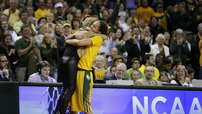 Baylor head coach Kim Mulkey, left, is lifted off her feet by Brittney Griner as Griner leaves the court in the second half of a second-round game in the women's NCAA college basketball tournament against Florida State, Tuesday, March 26, 2013, in Waco, Texas. Baylor won 85-47. (AP Photo/Tony Gutierrez)
