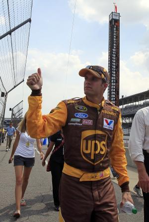 David Ragan acknowledges the fans after he qualified on the pole for the NASCAR Brickyard 400 auto race at the Indianapolis Motor Speedway in Indianapolis, Saturday, July 30, 2011. (AP Photo/AJ Mast)