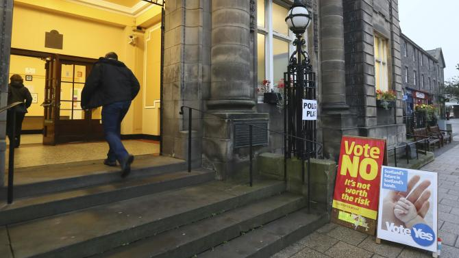 People arrive to cast their vote at Portobello Town Hall near Edinburgh, Scotland