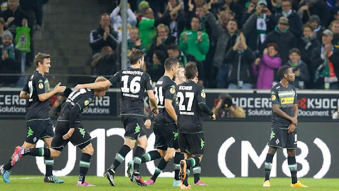 Moenchengladbach's Ibrahima Traore, right, celebrates with teammates after scoring , during the Europa League group A soccer match between Borussia Moenchengladbach and Apollon in Moenchengladbach, Germany, Thursday, Oct. 23, 2014. (AP Photo/Frank Augstein)
