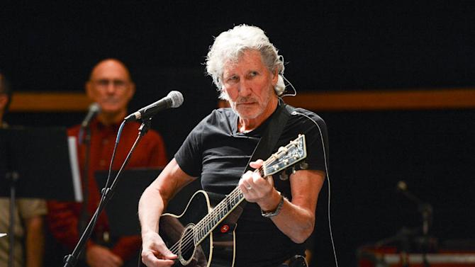 "Musician Roger Waters and his band hold rehearsals with members of the Wounded Warriors Project for the ""Stand Up For Heroes"" benefit concert presented by the New York Comedy Festival & the Bob Woodruff Foundation at S.I.R. Studios on Monday, Nov. 4, 2013 in New York. (Photo by Evan Agostini/Invision/AP)"