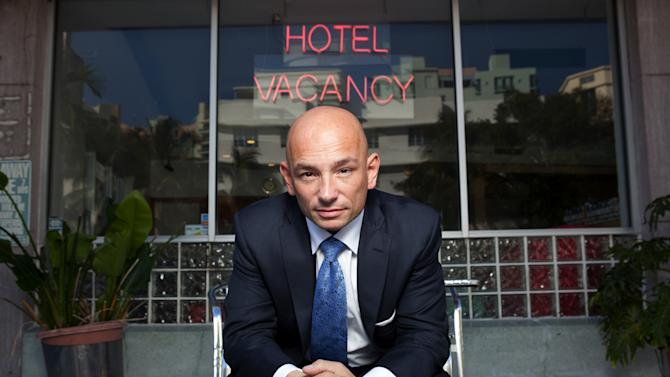 "This undated image from the Travel Channel shows Anthony Melchiorri, host of a new show called ""Hotel Impossible."" On the show, Melchiorri, who has been in the hospitality business for 20 years, advises hotels on improving facilities, service and decor. He describes himself as a ""germaphobe"" when it comes to hotel rooms, and his pet peeves as a guest include dirty grout and Internet fees. (AP Photo/Travel Channel)"