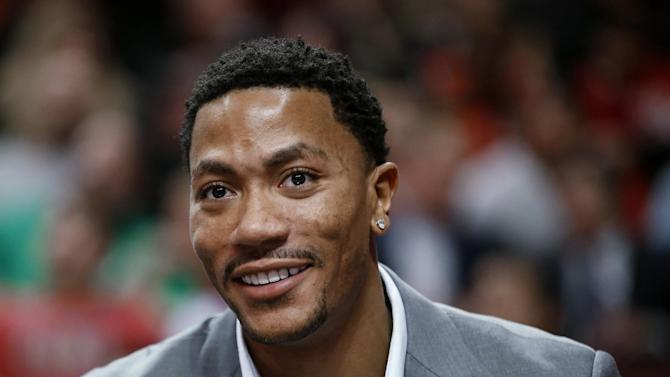 Injured Chicago Bulls guard Derrick Rose sits on the bench during the first half of the Bulls' NBA basketball game against the Milwaukee Bucks in Chicago, Friday, April 4, 2014