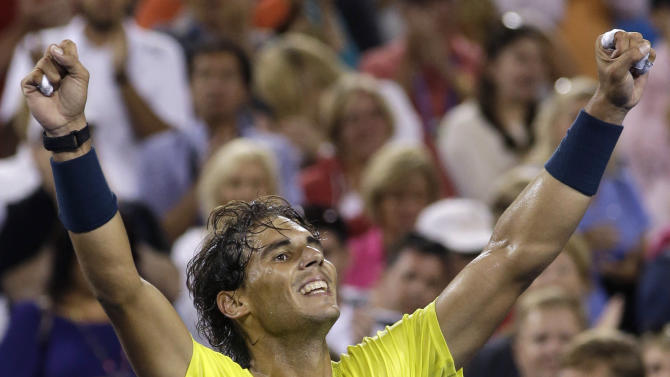 Rafael Nadal, of Spain, celebrates after defeating Roger Federer, from Switzerland, 5-7, 6-4, 6-3, during a quarterfinal at the Western & Southern Open tennis tournament, Friday, Aug. 16, 2013, in Mason, Ohio. (AP Photo/Al Behrman)