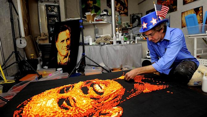 IMAGE DISTRIBUTED FOR CHEETOS - Artist Jason Baalman puts the finishing touches on a Cheetos portrait of President Barack Obama Tuesday, Oct. 2, 2012, in Baalman's Colorado Springs, Colo., studio.  Today, the Cheetos brand unveiled a new electoral polling model with the unveiling of 3 feet by 4 feet one-of-a-kind Cheetos portraits of the Democratic and Republican presidential nominees – President Barack Obama and former Gov. Mitt Romney. Debuting on Facebook today at 11 a.m. CT, fans are encouraged to vote for their candidate's portrait – made entirely of more than 2,000 individual Cheetos cheese snacks – for a chance to win the actual portrait. (Photo by Jack Dempsey/Invision for Cheetos/AP Images)