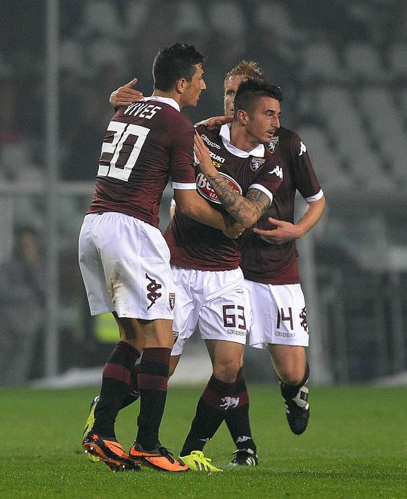 Torino's Bellomo celebrates with his teammates after scoring against Inter Milan during their Italian Serie A soccer match in Turin