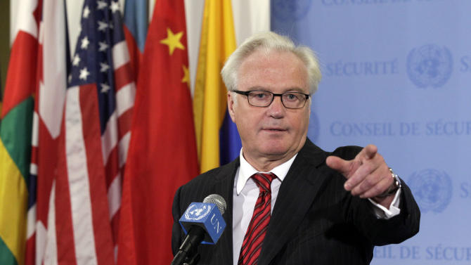 Russia's U.N. Ambassador Vitaly Churkin answers reporters' questions at the United Nations  after a closed meeting of the Security Council,  Thursday, Aug. 16, 2012. The Security Council will let the mandate for the U.N. military observer mission in Syria expire Sunday and will back a new civilian office there to support U.N. and Arab League efforts to end the country's 18-month conflict. Churkin said an action group will meet Friday to call for an end to the violence in Syria. (AP Photo/Richard Drew)