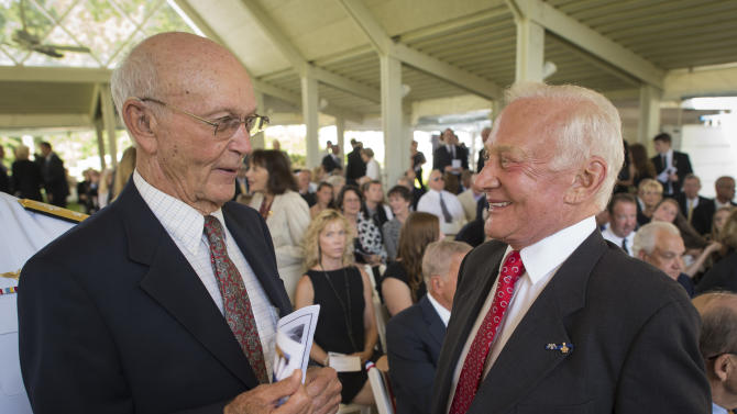 "Apollo 11 astronauts Michael Collins, left, and Edwin ""Buzz"" Aldrin, talk at a private memorial service celebrating the life of Neil Armstrong, Friday, Aug. 31, 2012, at the Camargo Club in Cincinnati. A national memorial service has been scheduled for Sept. 12 in Washington. Armstrong, the first man to walk on the moon during the 1969 Apollo 11 mission, died Saturday, Aug. 25. He was 82. (AP Photo/NASA, Bill Ingalls)"