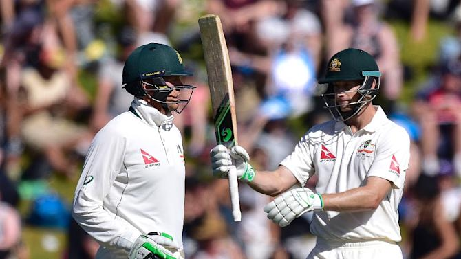 Australia's Adam Voges (R) celebrates 150 runs with teammate Peter Siddle during day two of the first Test match against New Zealand in Wellington on February 13, 2016