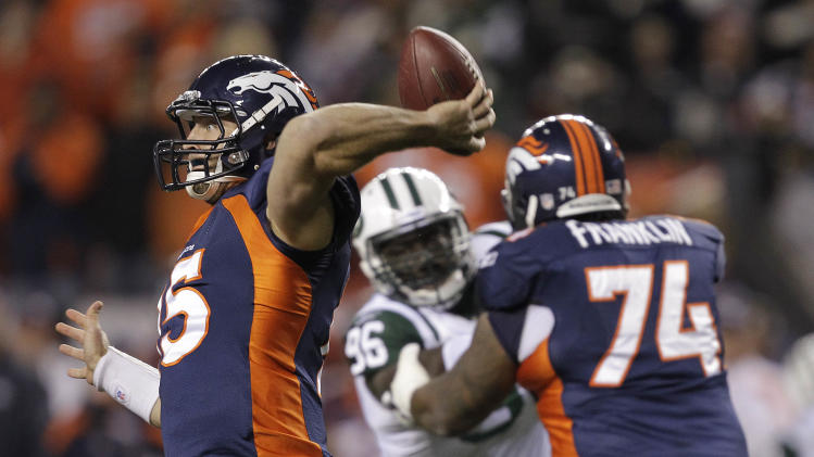 Denver Broncos quarterback Tim Tebow (15) throws against the New York Jets in the first quarter of an NFL football game Thursday, Nov. 17, 2011, in Denver. (AP Photo/Julie Jacobson)