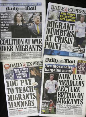 Recent editions of Britain's Daily Express and Daily Mail newspapers, featuring headlines about immigration, are photographed in London, Friday, Dec. 27, 2013. For months, Britain's tabloids have repeatedly warned of the horrors they believe will ensue after Jan. 1, 2014 when work restrictions will be lifted across the European Union for migrants from Romania and Bulgaria — two of the trading bloc's newest members. Those changes, the papers claim, will unleash a mass exodus of the poor and unemployed from the two eastern European countries to Britain. (AP Photo/Alastair Grant)