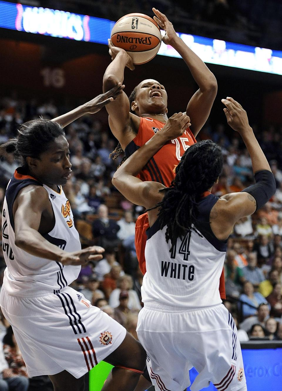 Tan White leads Sun past Mystics, 77-70