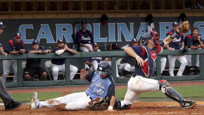 North Carolina's Skye Bolt slides into home ahead of a throw to Florida Atlantic catcher Levi Meyer during the fifth inning at the NCAA college regional baseball tournament in Chapel Hill, N.C., Sunday, June 2, 2013. The run, made possible by a sacrifice fly by North Carolina's Michael Russell, put North Carolina up 2-0.  (AP Photo/Ted Richardson)