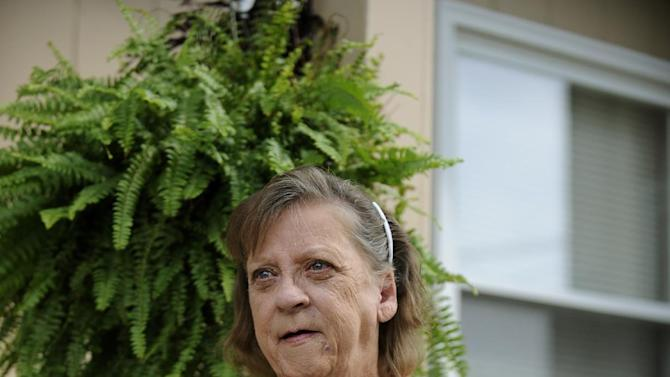 CORRECTS TYPE OF MENINGITIS TO FUNGAL INSTEAD OF BACTERIAL - Patsy Bivins, 68 of Sturgis, Ky., sits on her porch with her dog Little Britches at her apartment in Sturgis, Ky., Friday, October 5, 2012. Bivins was injected with steroids at St. Mary Sugricare in Evansville, Ind., who notified her of possibly being infected with fungal Meningitis. (AP Photo/Stephen Lance Dennee)
