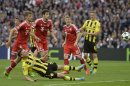 Dortmund's Lukasz Piszczek of Poland, left on ground, shoots at the goal, during the Champions League Final soccer match between Borussia Dortmund and Bayern Munich, at Wembley Stadium in London, Saturday May 25, 2013. (AP Photo/Martin Meissner)