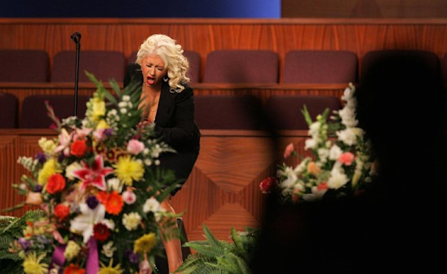 Christina Aguilera performs at the funeral of singer Etta James, Saturday, Jan. 28, 2012, at Greater Bethany Community Church City of Refuge in Gardena, Calif. James died last Friday at age 73 after battling leukemia and other ailments, including dementia. She was most famous for her classic &quot;At Last,&quot; but over her decades-long career, she became revered for her passionate singing voice. (AP Photo/Ringo H.W. Chiu)