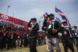 """Members of """"Volunteers' Ward to protect the Nation's Democracy"""" group take part during march marking end of two days training at stadium in Nakhon Ratchasima"""